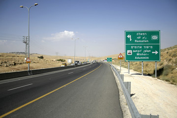 road sign going down to the dead sea region