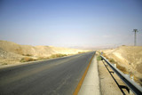 desert road leading to the dead sea region poster