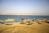 parasol on dead sea beach  resort poster