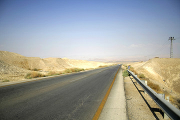 desert road leading to the dead sea region