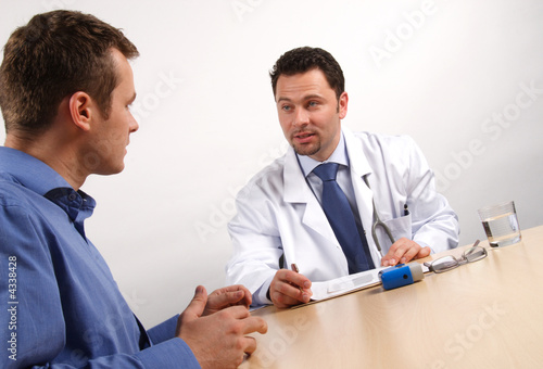 male patient nad doctor talking