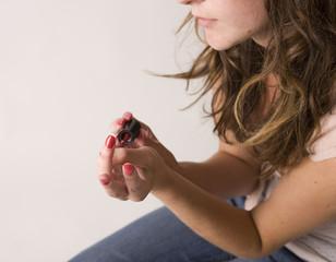 woman painting nails 03