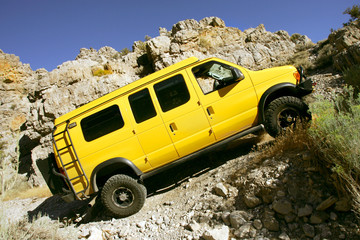 4x4 yellow van off road in Kings Canyon, Utah