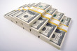Stacks of Hundred Dollar Bills on a white background.