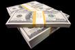 Stacks of Hundred Dollar Bills on a Black Background.