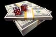 Stack of Hundred Dollar Bills & red dice on a black background.