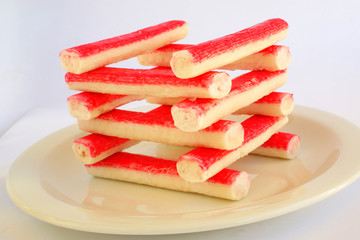 Frozen crab sticks on the plate