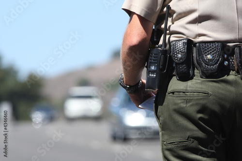 canvas print picture A police officer standing by traffic
