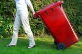 Person pulling wheelie bin poster