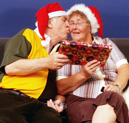 Elderly couple having a kiss at christmas