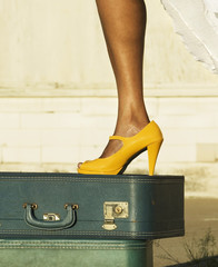Leg and shoe on a suitcase