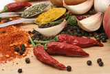 Fototapety red peppers and other spices with garlic and onion