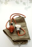 Old blood pressure cuff isolated on white background poster