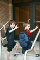 Two Boys Going into School