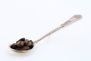 Spoon with bean coffee