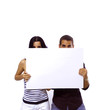 Young couple holding a blank banner - isolated