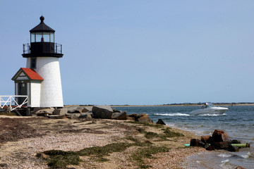 lighthouse and speedboat
