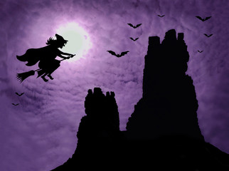 Halloween background with dark ruins, witch and bats