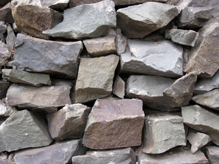 Close up of a stacked stone facade