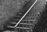 Staircase in brick and iron poster