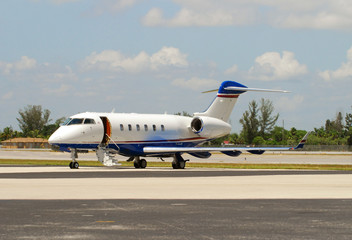 Private learjet parked on runway