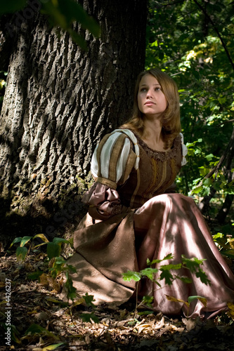 Beautiful princess in a dark forest