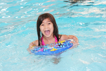 Five year old girl excited about swimming