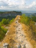 Pathway and precipice in mountains poster