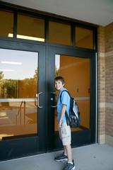 Boy Going into School