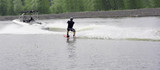 waterskier ski on water board after a speed motorboat