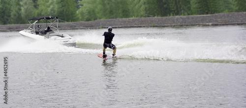 waterskier ski on water board after a speed motorboat