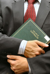 lawyer holding criminal law book
