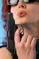redhaired woman with pistol