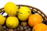 Lemons, oranges and hazelnuts isolated on white poster