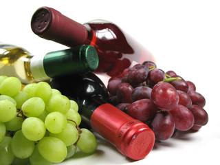 bottles of wine with grapes