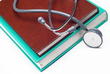 Stethoscope and medical books poster
