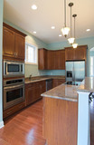 modern kitchen with cherry cabinets poster