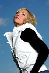 Beautiful blonde over sky background