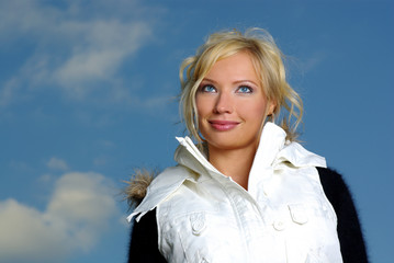 Winter woman over blue sky