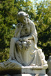 Granite statue of a young girl in a cemetery