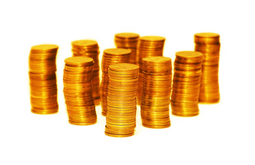 Stacks of gold coins isolated on the white