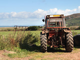 Agricultural Tractor on a Field overlooking the Sea poster