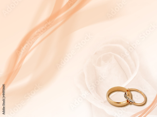 Wedding rings on abstract smooth background