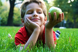 boy with an green apple