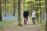 Retired man and woman cycling poster