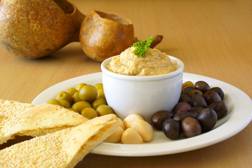 Hummus with assorted pickles and pita bread