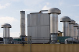 Factory roof with heating and ventilation chimneys poster