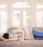 Young woman sleeps on the sofa poster