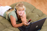 Teenager girl with laptop and cell phone poster