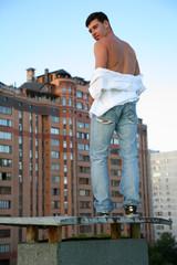 man against urban landscape